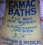 An advertising banner from the Camac Baths.