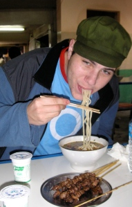 Ben Eisenberg sampling the local food in Kunming, China.