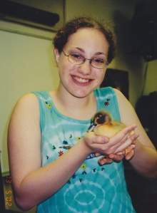 Samantha Eisenberg with a baby duck, one in a long line of pets.