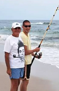 Michael Scolnic fishing with his Pop (Stanley).