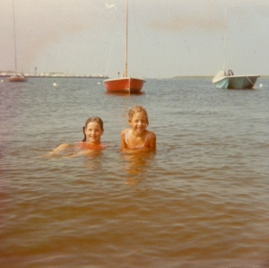 Ellen, age 10 (left) and her sister Susan, 7, swimming in Barnegat Bay.  and my sister Susan is on the right, swimming in the bay. I'm 3 years older, so I think I'm 10 and she's 7?